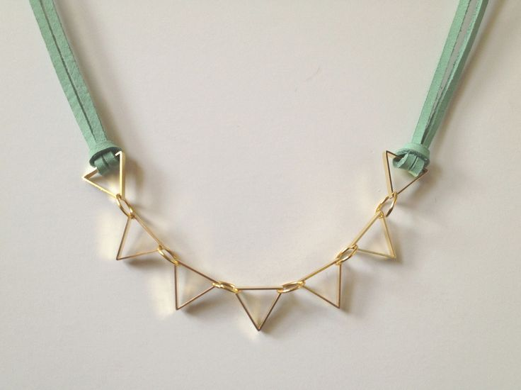 DIY Leather and Metal Geometric Necklace Tutorial by fabric paper glue here. Besides being a really easy jewelry DIY, I like the adjustable length (preferring shorter to longer for this necklace).