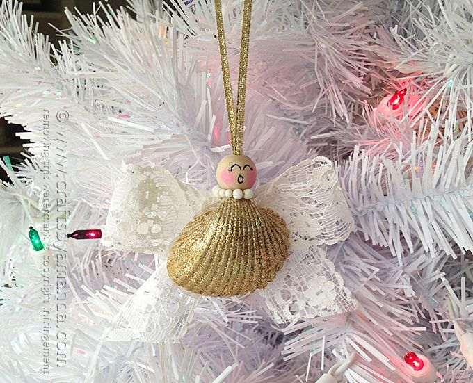 Every year I make a couple new ornaments for Christmas. This seashell angel ornament was one of those and she looks lovely hanging on the tree.