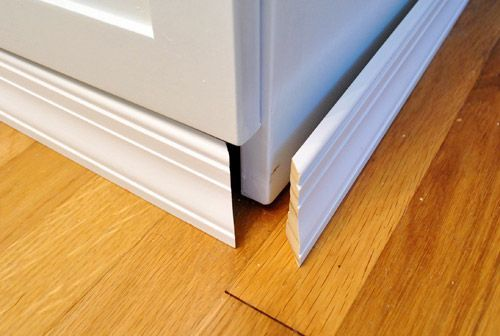 Add baseboard for a solid built in look! - Would love to do this! But would have to find it in the same stain as my cabinets!
