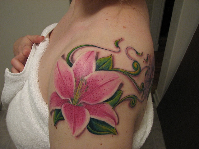 stargazer lily, to remember my mom someday. tad higher on the shoulder though!