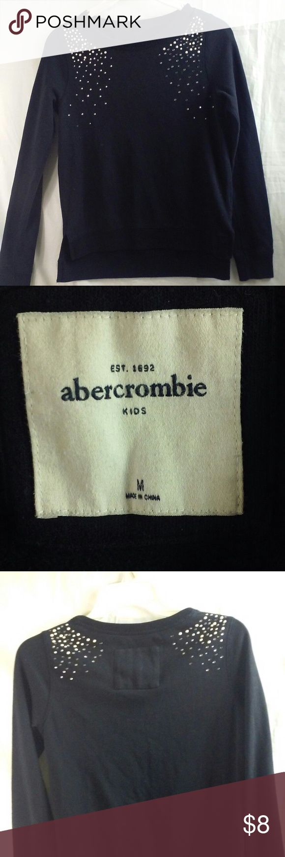 """Abercrombie Girls Black Knit Top Size Medium This is a pre-owned Abercrombie kids embellished knit top. Armpit to Armpit measures 16"""" Length from Shoulders to hem is 21"""" Arm length from Shoulder seam to cuffs is 22.5"""" Shoulders is 12.5"""" Has some missing rhinestones.  Don't hesitate to send offers, will accept any reasonable offer. abercrombie kids Shirts & Tops Tees - Long Sleeve"""
