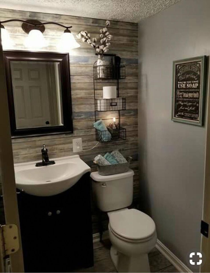 The wall of hardwood is a great accent! Also great use of space added with the s…   – bathroom shelves