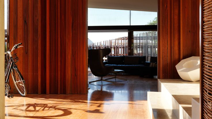 warm tones with geometrical feature by the stairs and the feature piece.   Gallery of Queenscliff Residence / John Wardle Architects - 10