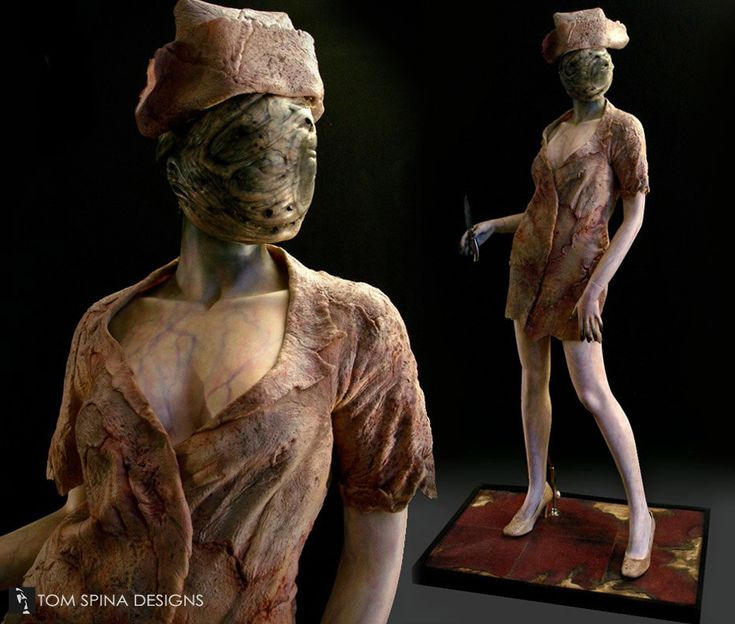 """Original Dark Nurse costume displayed on a customized mannequin that captures the """"creepy/sexy"""" look from the film Silent Hill.  The heavily weathered base reinforces the eerie atmosphere."""