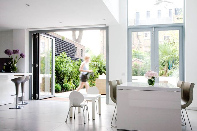 Wakehurst Road - Granit Architects. Bright, open, family space. White features for clean and crisp finish. Large format tiles.
