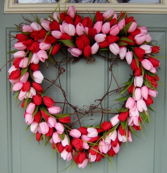 This is a heart shaped wreath that measures about 21 inches long by 19-20 inches wide from flower to flower. It is covered with beautiful artificial