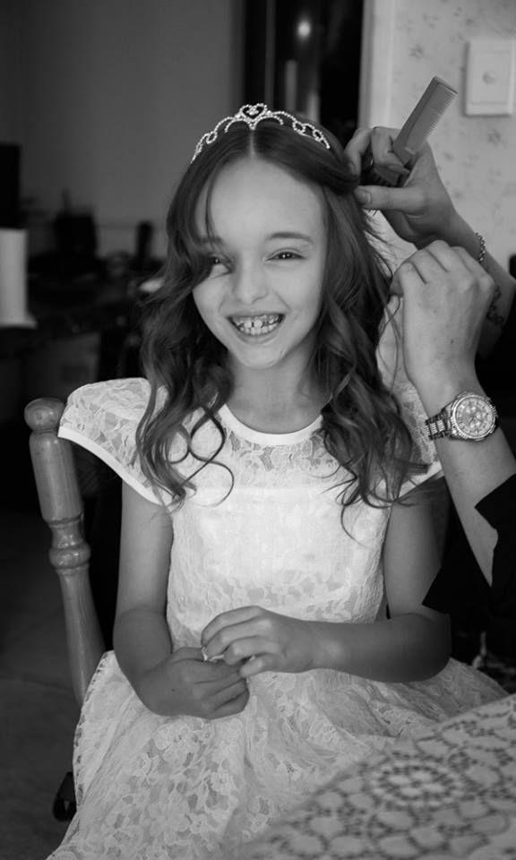 Flower girl getting ready.   Timika Prygoda woodnote Photography