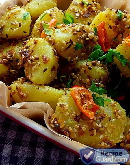 Spicy curry potatoes with sesame seed