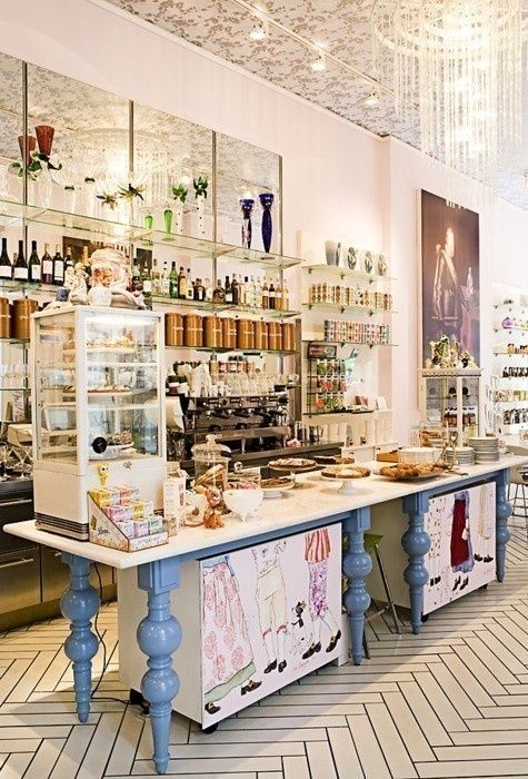 Love the use of space under the table and the cute artwork!  Pastelería y Coffee Shop - #bakery #coffee #shop