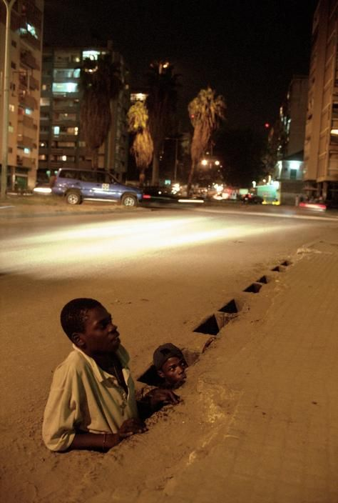 Chris Steele-Perkins I  ANGOLA. Street Children in Luanda. Street kids come out…