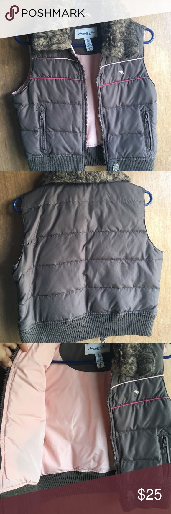 """A&F down best. Size M (runs small though). In great shape. Abercrombie and Fitch down vest. Size Medium but fits more like a small. Brown exterior with a peachy pink interior. Hot pink and pale pink piping stripes on breast of exterior. Side zippered pockets. Length from top of shoulder to bottom of vest is 19"""". Abercrombie & Fitch Jackets & Coats Vests"""