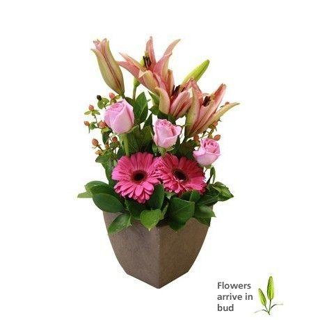 Arrangement of pink lilies, roses & gerberas