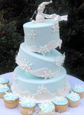 Winter cake, with a skiing snowman topper!  @deanna hughes hughes hughes hughes Judin, think we could do this?