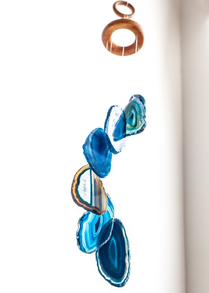 This gorgeous mobile is made with vibrant and colorful agate slices, draping gracefully from a wooden ring. It is a perfect piece of outdoor decor for your bohemian patio setup, but it also looks amaz