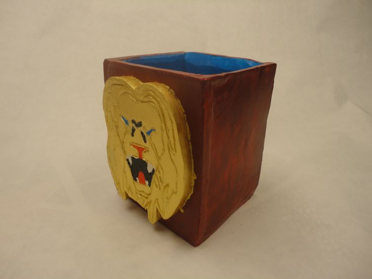 Brandy: My Hero's Journey Box was made using slab. Each side and the bottom is slab as well as the lion faces on the two sides. The little lion is Simba and the bigger face is Mufasa. For my Hero's journey I picked The Lion King. The colors were picked to symbolize meaning. The gold is showing loyalty, the red is betrail between Mufasa and Scar, and the blue is the bond between father and son.