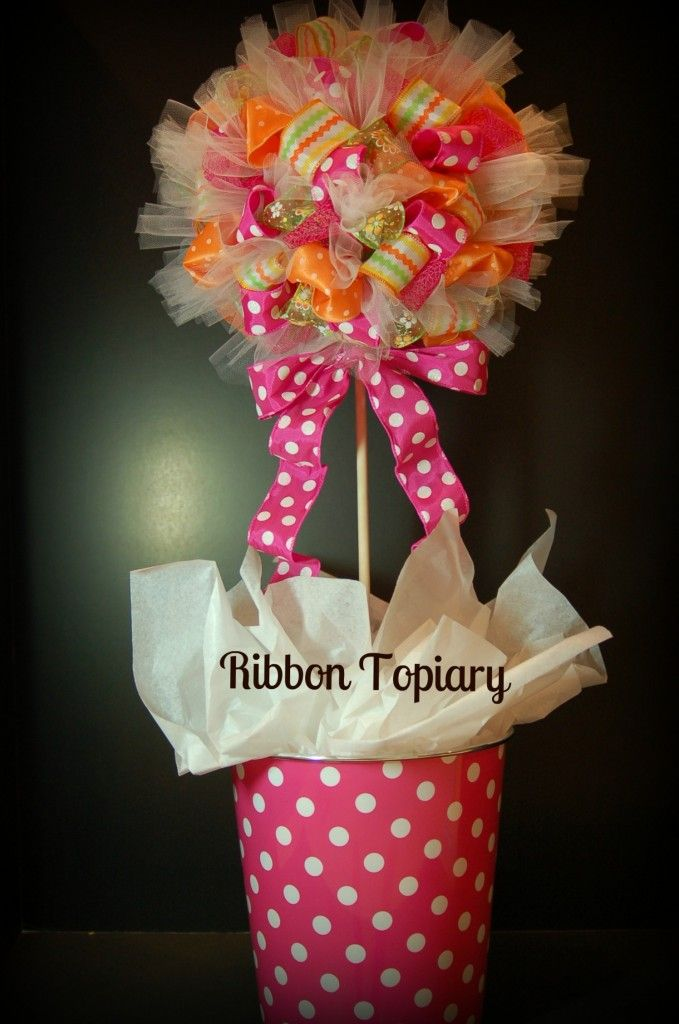 Make a ribbon topiary....change colors to coordinate with holidays, party themes, etc.....very cute tutorial
