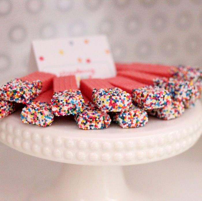 Sprinkle party - dip sugar wafers in chocolate, then sprinkles! Khiya loooooves sugar wafers! Maybe a fun cheap sweet treat to go with the cake/cupcakes. Pink sugar waffers dipped in white chocolate with brown sprinkles!