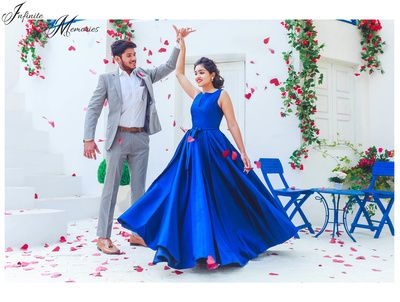 royal blue sleeveless gown, couple dancing shot, romantic shot, twirling bride shot, grey suit