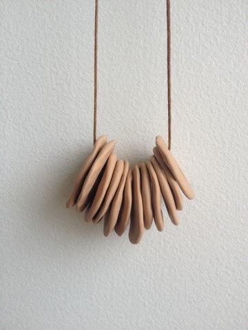 Tan Hand Shaped Polymer Clay Necklace by hopeofallhearts on Etsy, $18.00