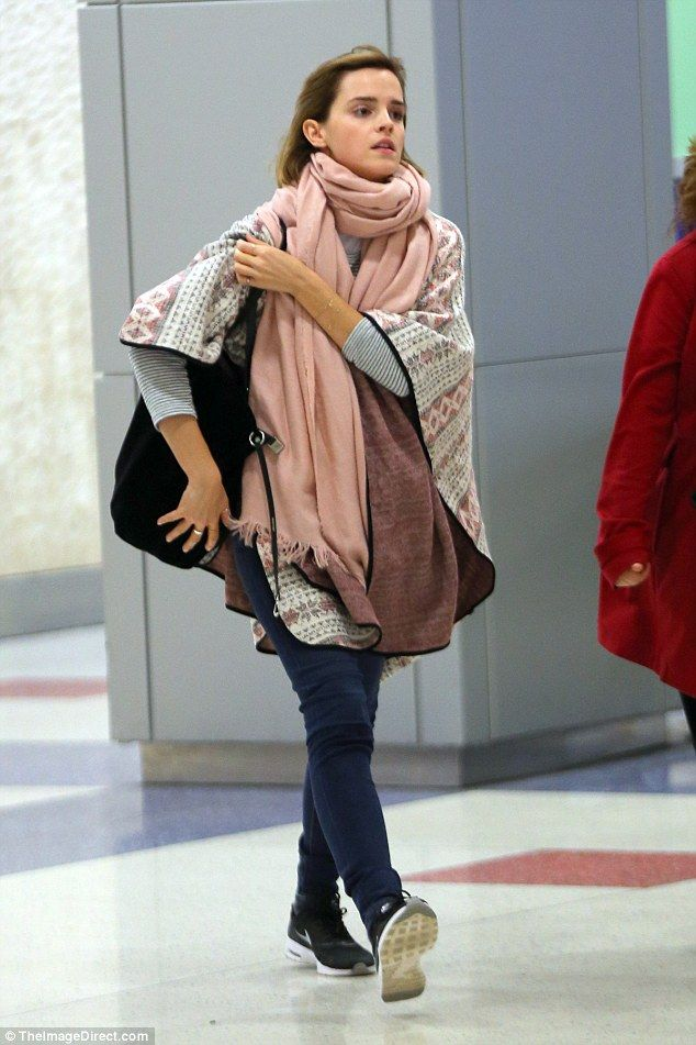 Emma Watson cuts a super casual figure as she jets into New York