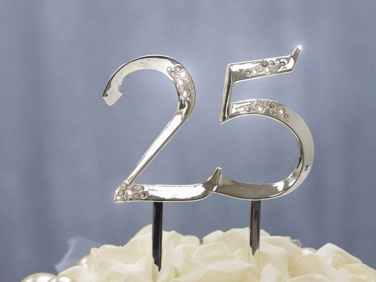 UNBEATABLE at 25 Silver Cake Topper | You have successfully completed 25 triumphant years of glory, it's time to celebrate and cherish this amazing venture. Whether it is the 25th Silver Wedding Anniversary, 25th Birthdays, or victorious 25 years in your professional and business excellence, our lustrous Silver number 25 cake topper will give your celebratory cake a whole new festive flair and jovial look. Featuring glistening silver finish and glamorous rhinestone accents, this silver…
