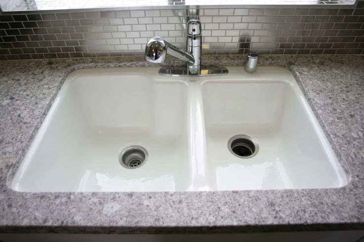 White Ceco Cast Iron Kitchen Sink We Included A Two Compartment Finish With Chrome Pull Out Faucet Newhome