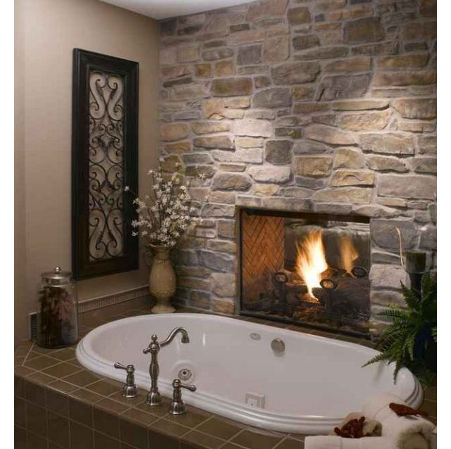 Two way fireplace with one side next to bathroom and the for Three way fireplace