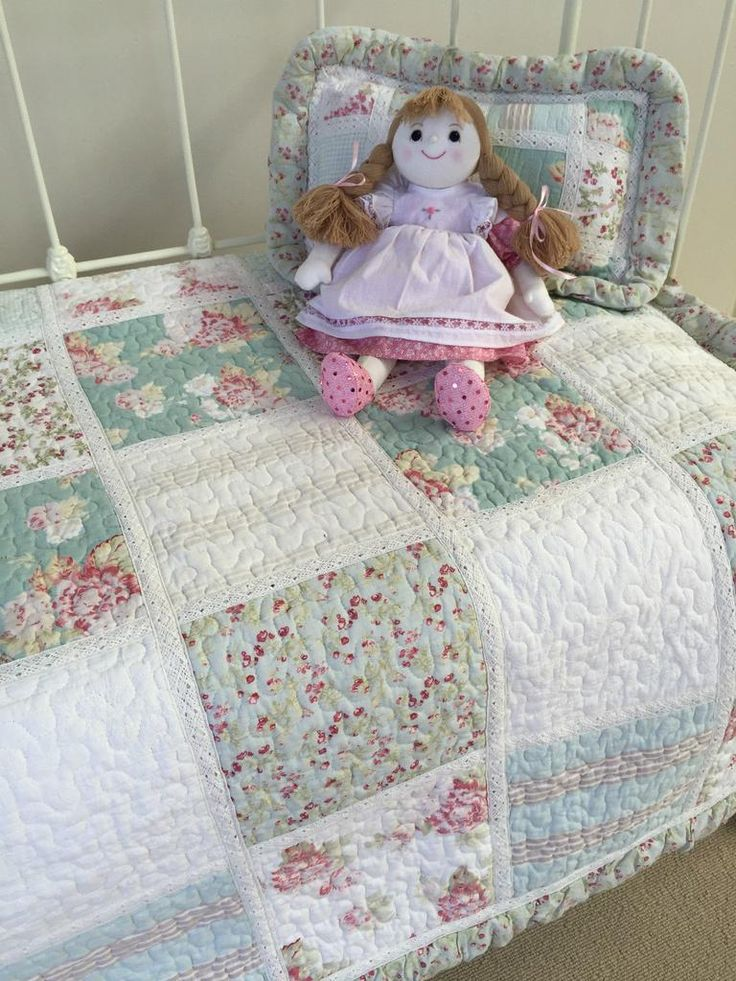 Hannah cot quilt from the Lovely Linen Store. This very pretty combination of colours and fabrics with special details such as lace trims, surface stitching and a soft piped ruffle border makes this a quilt design to be admired.  #LovelyLinen #LovelyLinenStore #NurseryCotQuilts #GirlsNursery