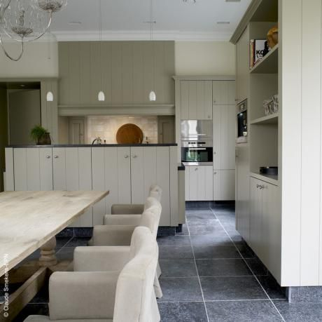 slate floors rustic scrubbed wood table and slip covered chairs for a perfect contemporary country kitchen - Landelijk