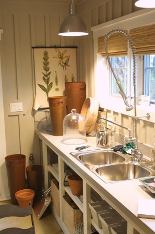 Who would have thought that a mudroom could be so quaint? In the 2003 Dream Home, the mudroom contains an industrial-sized sprayer and uses the wood blinds and terra-cotta planters as decor.