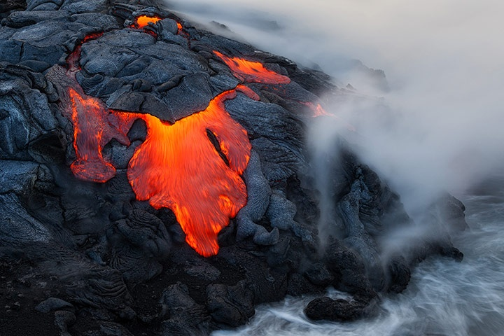 Lava flow from the Kilauea volcano enters the sea south of Kalapana in Big Island, Hawaii. Photographer Miles Morgan was just one metre away from the source of the eruptions