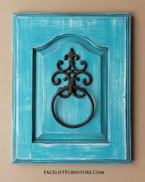 Towel Holder in heavily distressed Turquoise with Black Glaze, revealing white primer.  Repurposed from small cabinet door.