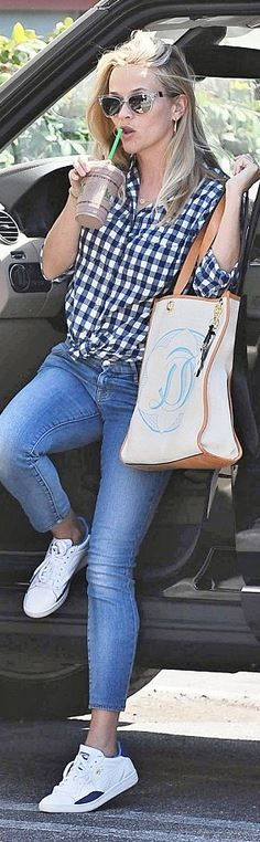 Who made  Reese Witherspoon's clear sunglasses, tan tote handbag, blue gingham print shirt, and white sneakers?