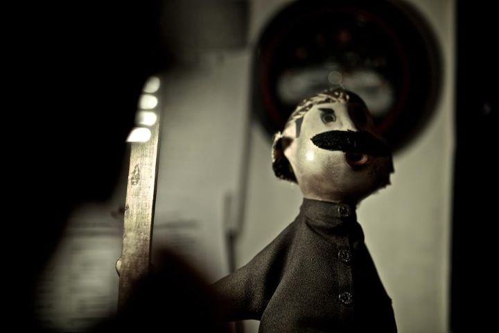 Pak Raden wooden doll.