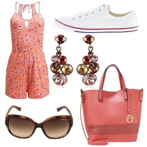 Outfit da indossare per una vacanza in una città molto calda ed è composto da tutina color salmone a fantasia, converse bianche basse (per la comodità), mentre il tocco glamour lo danno i maxi occhiali da sole Vogue, la shopping bag corallo e gli orecchini pendenti con pietre