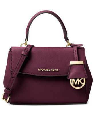 """Signature Saffiano leather lends structure and style to this fabulously feminine mini crossbody bag from Michael Michael Kors.   Saffiano leather; lining: polyester   Imported   Mini sized bag; 7-1/2"""""""