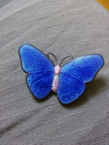"""You are looking at a vintage sterling & enamel butterfly pin tht has likely a Norwegian maker. Beautiful blue, pink and white colors. The pin measures 1 1/4"""" by 13/16"""".  All items sold might need to be polished or cleaned as we sell them as we receive them. If you have any questions please ask prior to bidding. Thank you for looking and happy bidding."""