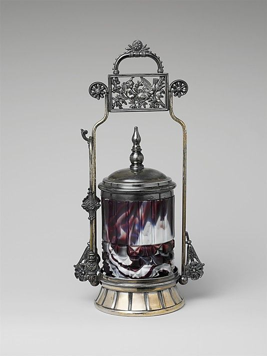 Pickle jar Challinor, Taylor and Company (1866–1891)  Date: 1870–90  Geography: Mid-Atlantic, Tarentum, Pennsylvania, United States  Culture: American Medium: Pressed purple marble glass, metal