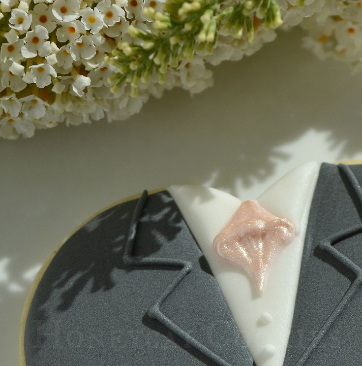 Groom on a heart decorated cookie