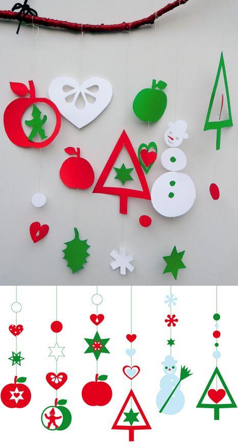 une belle branche • du papier cartonné rouge, vert, blanc • de la ficelle fine blanche • des ciseaux ou un cutter • un crayon