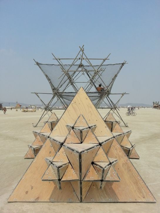 Front view of the Fractal Cult timber pods and Scaffolding