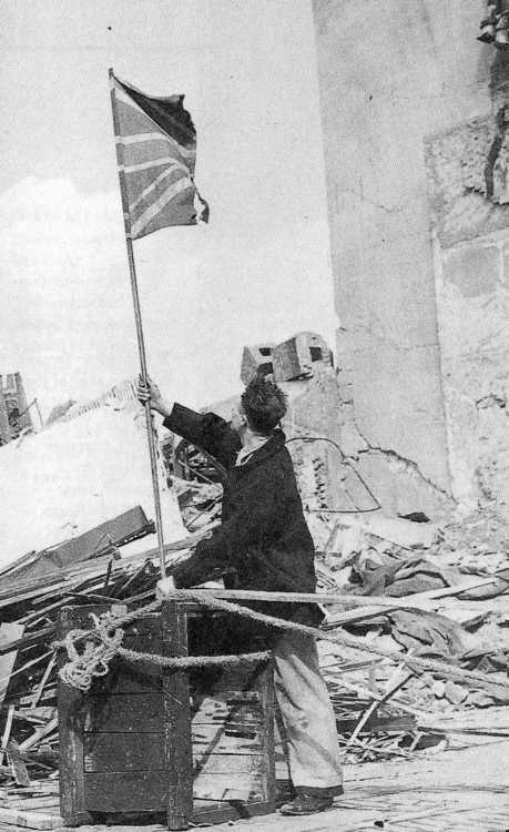 Defiance in the face of the Luftwaffe: A householder, already bombed out, flies the Union Jack in London, September 1940. In this particular case, a raid has ripped the flag in two, but the message is clear.