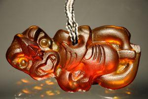 Raewyn Roberts Kura Gallery Maori Art Design New Zealand Cast Glass Art Large Tiki Pendant  Tangerine