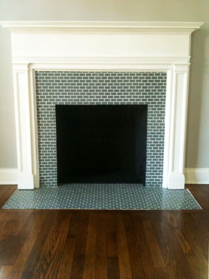 gray brick tile clad firebox surround and hearth beautifying white modern mantle over wooden parquet: classic mosaic fire place design and idea for impression of the past