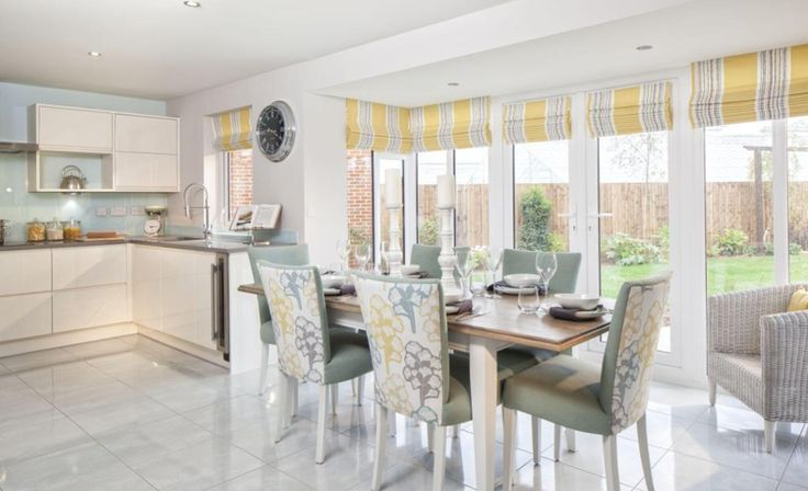 Interior Designed contemporary/modern kitchen / living / dining room using a fresh scheme of yellow, pale dove grey and sage greens. Love the tree / stylised Ginko Leaf fabric on the chairs. David Wilson Homes