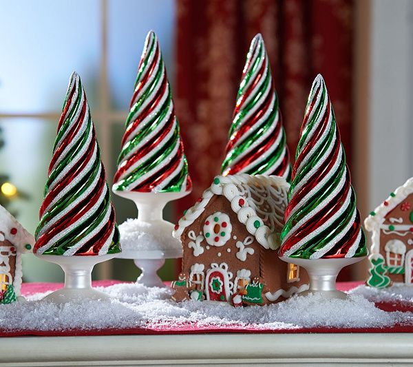 Sweet swirls. Bring some fun color to your Christmas collection with this set of four whimsical trees by Valerie Parr Hill. QVC.com
