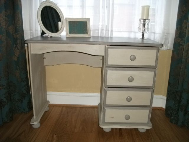 I Upcycled this dresser using Annie Sloan chalk paint in 'French Linen' and 'Country Grey' then shabbied and waxed to seal. Then polished!
