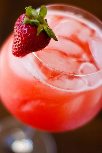 Strawberry wine coolers.  1 pound fresh strawberries, rinsed and hulled  2 ounces vodka  generous pinch of kosher salt  2 750-mL bottles off-dry white wine, such as an American Reisling, chilled