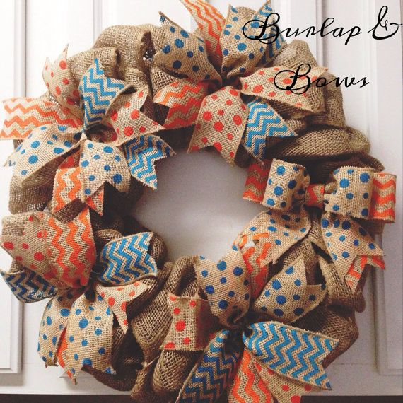 Perfect for spring/ summer! This wreath has teal polka dots, orange polka dots, and orange & teal chevron burlap ribbon. Please allow 1-2