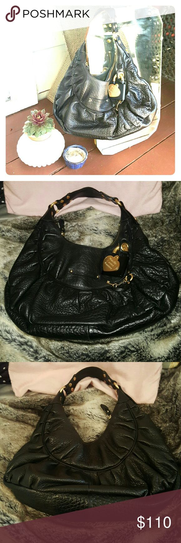 Authentic Juicy Couture Black Leather Purse Beautiful authentic juicy couture leather black purse with gold hardware and adorable lock and key accessory on front. Barely used, in excellent condition.  Comes with original pink dust bag. Juicy Couture Bags Hobos